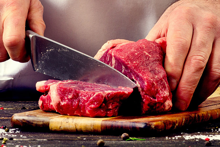 Chef cutting meat